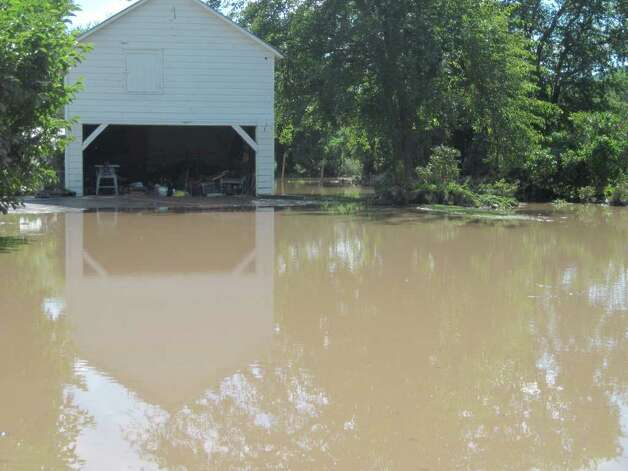 Flood waters still remained in parts of the village of Schoharie a day after Hurricane Irene. (Christopher Lisio)