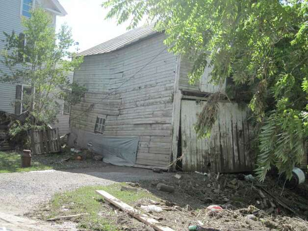 A barn on Main Street in Schoharie was ripped from its foundation, landing just feet away from the main road after historic flooding caused by Hurricane Irene ravaged the area. (Jennifer Patterson)