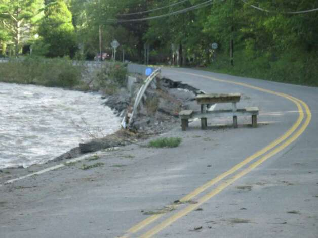 A picnic table came to rest on Route 443 in Schoharie after historic flooding caused by Hurricane Irene. (Christopher Lisio)
