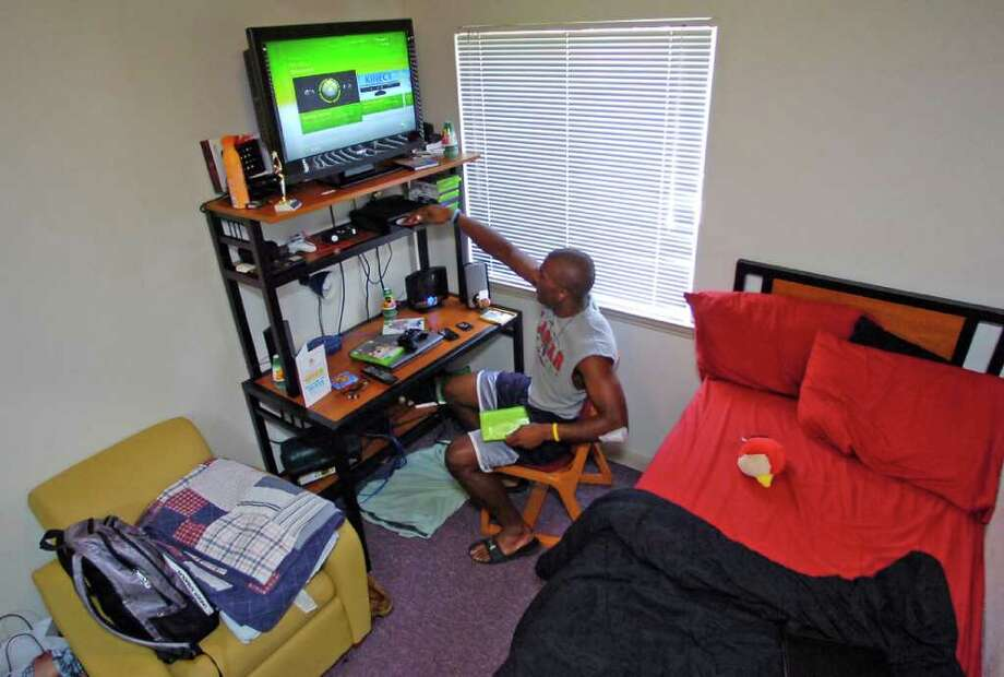 J.J. Hayes is now a Lamar University football player who lived briefly in a Chevy van while he was a student at Diboll High School. This is where Lamar University Head Football Coach Ray Woodard found him the day he went to sign him to play for Lamar.   He now lives in a dormitory at Lamar University and loves to play video games in his free time.  On his bed is a prized possession, a stuffed Cardinal know as Seymour.  Dave Ryan/The Enterprise Photo: Dave Ryan
