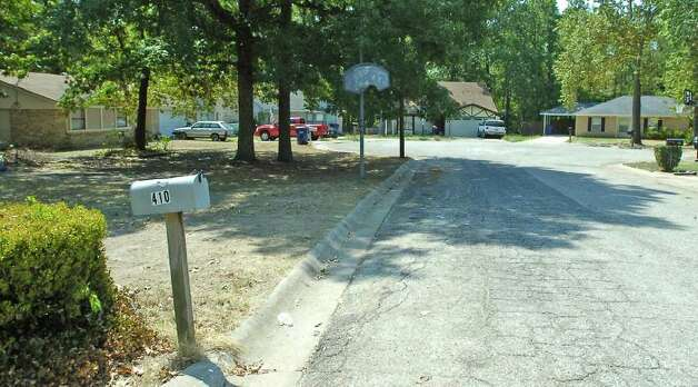 On this street, sometimes parked between the mailbox and the basketball hoop, in front of Lisa Gilbert's home, J.J. Hayes' van could be found with him sleeping in it.   Hayes is now a Lamar University football player who lived briefly in a Chevy van while he was a student at Diboll High School. This is where Lamar University Head Football Coach Ray Woodard found him the day he went to sign him to play for Lamar.   Dave Ryan/The Enterprise Photo: Dave Ryan