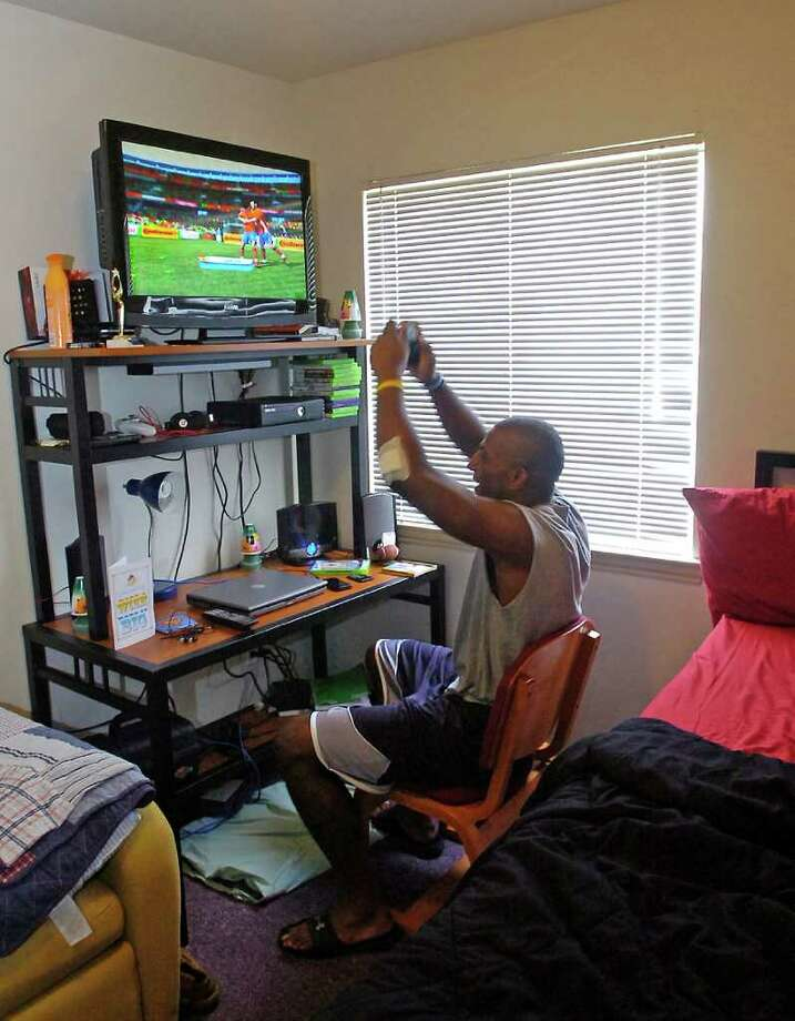 J.J. Hayes is now a Lamar University football player who lived briefly in a Chevy van while he was a student at Diboll High School. This is where Lamar University Head Football Coach Ray Woodard found him the day he went to sign him to play for Lamar.   He now lives in a dormitory at Lamar University and loves to play video games in his free time.  Dave Ryan/The Enterprise Photo: Dave Ryan