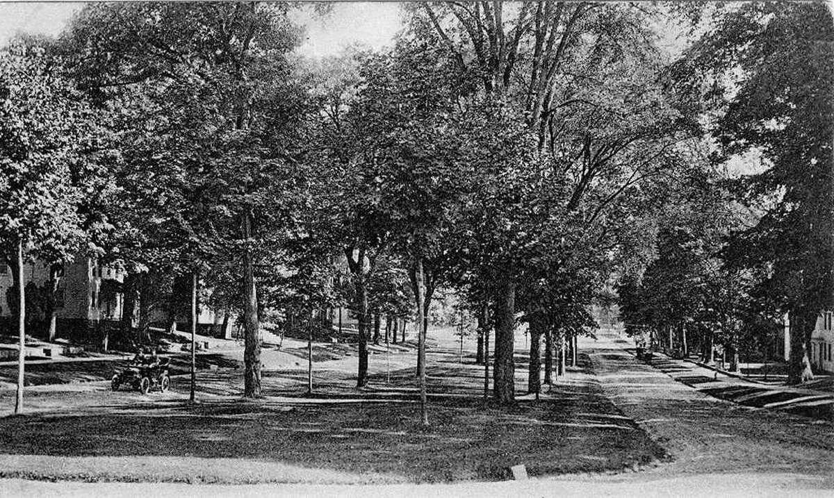 A favorite leisuretime pastime for motorists for many, many years in Greater New Milford has been the slow and relaxing ride around the expansive Village Green in the historic village center. This postcard, dated 1908 and found recently in an an antique store in Maine by New Milford High School School teacher Stephen Flanagan, shows a couple riding north along the Green in one of those new-fangled