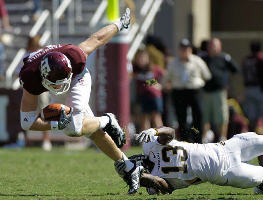 Ryan Tannehill (17) and the Aggies are off the SEC. ( Julio  Cortez / Houston Chronicle)