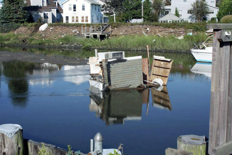 The bathroom from a partially collapsed home on Fairfield Beach Road fell into Pine Creek Wednesday morning. Photo: Contributed Photo / Fairfield Citizen