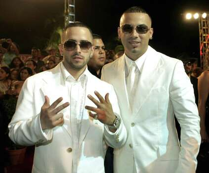 **FILE** Puerto Rican Reggaeton artists Wisin & Yandel pose as they arrive on the red carpet in this Feb. 23, 2006 file photo. Wisin & Yandel are being nominated for a Latin Grammy for Best Urban Music Album, Thursday, Nov. 2, 2006. Photo: ALAN DIAZ, AP Photo/Alan Diaz, File / AP2006