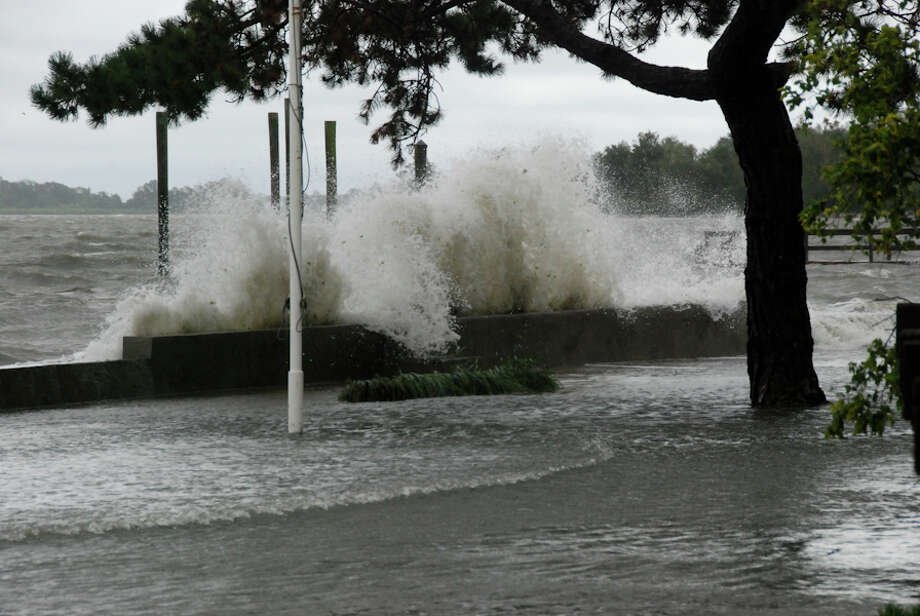 During tropical storm Irene, a wave crashes over a seawall at 12-14 Harbor View Ave. Photo: Jason Farrow