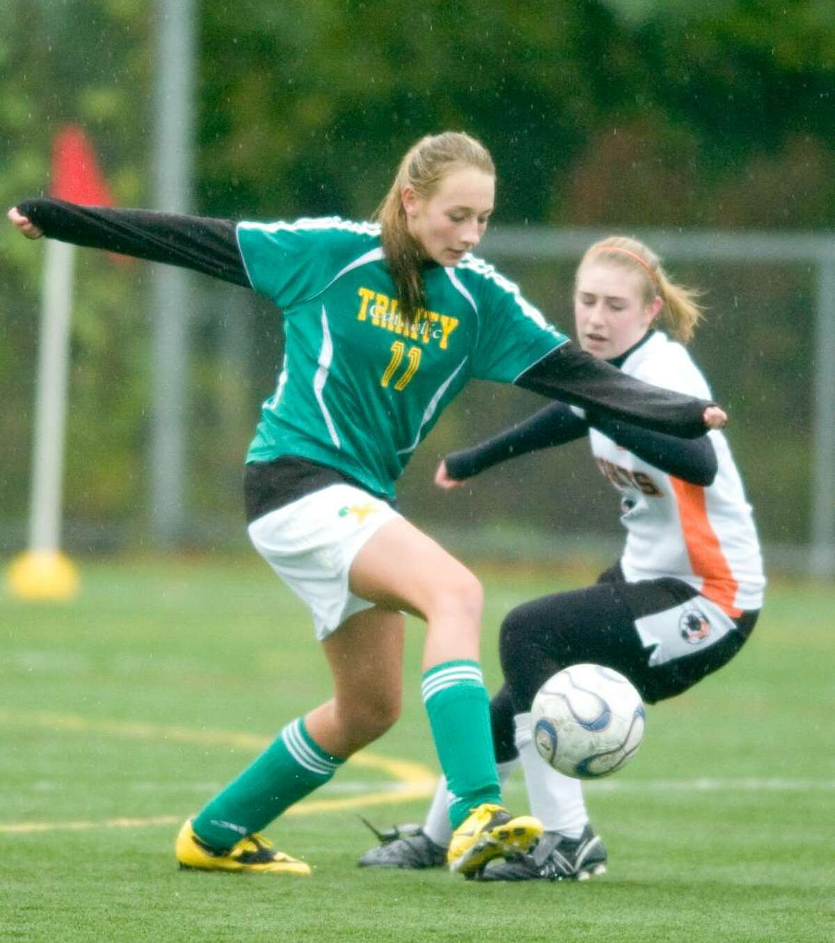 Trinity's Mackenzie Griffin, left, and Stamford's Kaitlyn Fitzpatrick, right, during and FCIAC girls soccer game at Stamford High School in Stamford, Conn. on Thursday, Oct. 15, 2009.