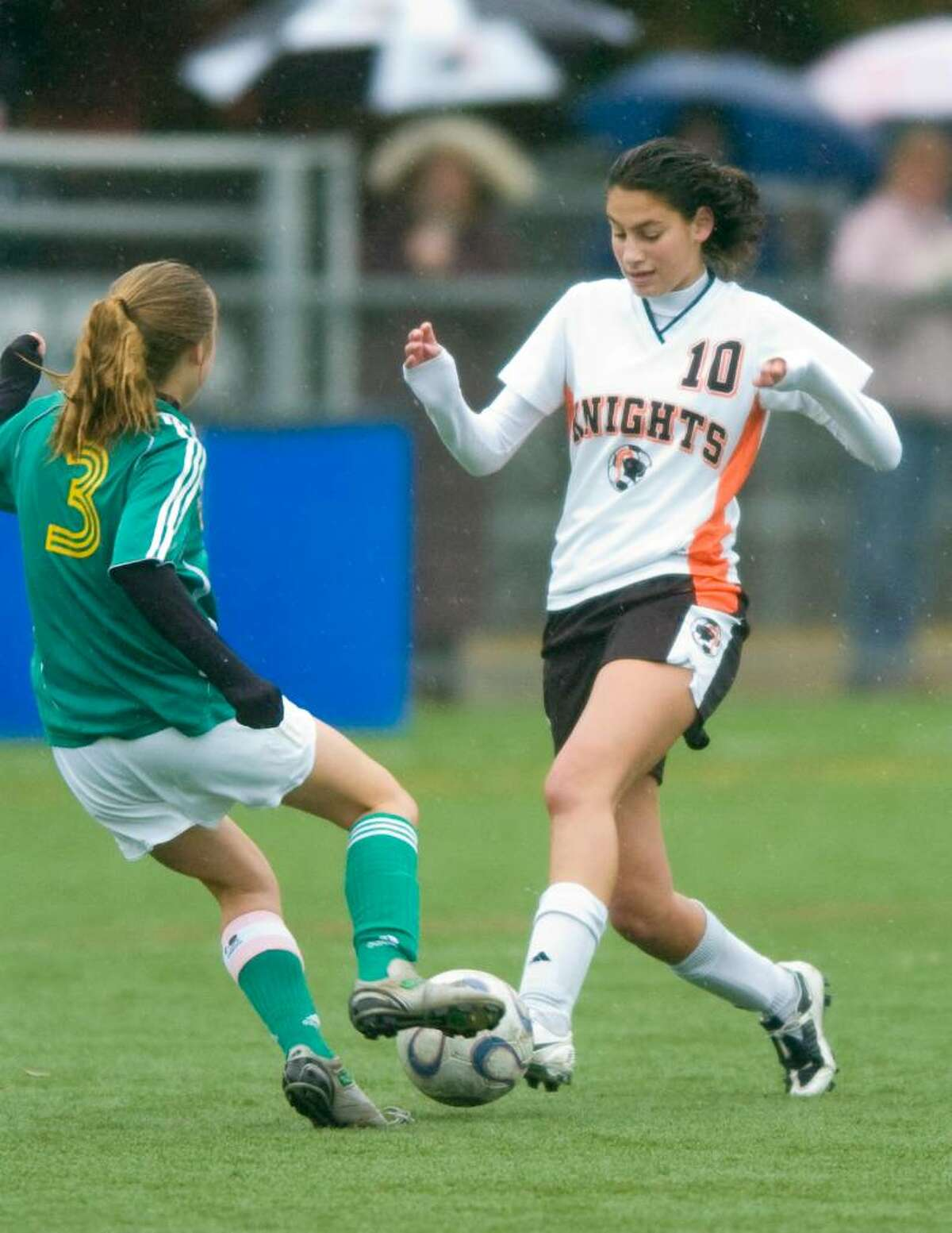 Stamford's Lauren Schapiro, right, and Trinity's Riley Northrop, left, during and FCIAC girls soccer game at Stamford High School in Stamford, Conn. on Thursday, Oct. 15, 2009.