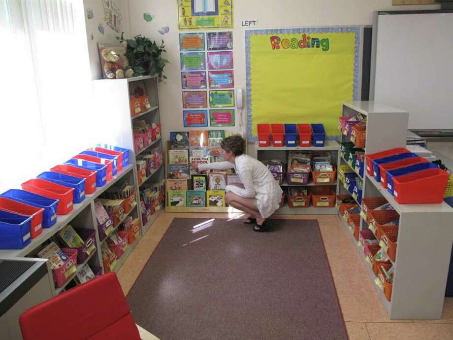 Megan Jaffe, a second grade teacher at South Elementary School, is setting up her classroom for the brand new year. All New Canaan Schools are slated to open on a 90 minute delayed schedule Sept. 1. Photo: Paresh Jha