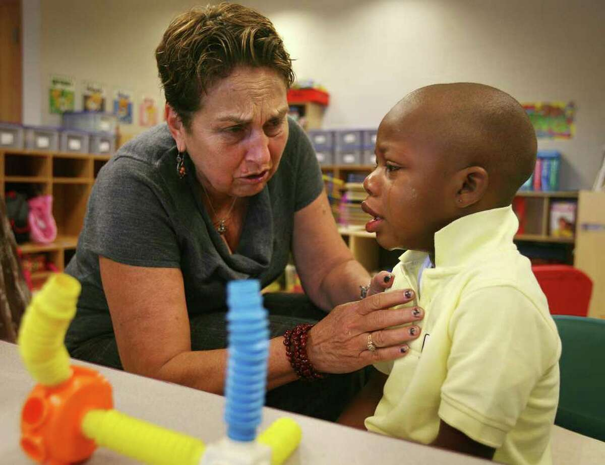 Principal Ann de Bernard comforts four-year-old Zyon during his first day of pre-kindergarten at Waltersville School in Bridgeport on Wednesday, August 31, 2011. Minutes later Zyon was smiling and playing with the other children.