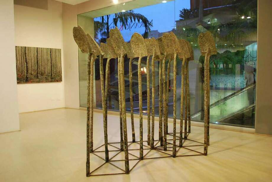 Colombian artist John J. Bedoya's 'Cultivo,' created from shovels, sand, iron and acrylic, will be among the artist's works on display at the Fernando Luis Alvarez Gallery, located at 96 Bedford St., Stamford. This is the artist's first solo exhibition in the United States. An opening reception takes place 6 to 9 p.m., Friday, Sept. 9. Photo: Contributed Photo