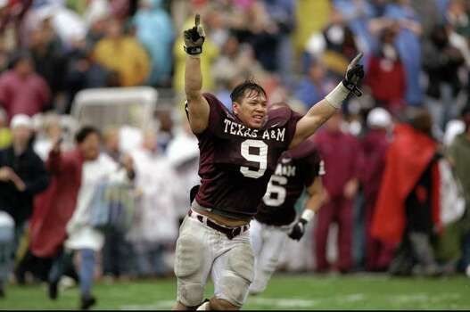 Linebacker Dat Nguyen #9 of the Texas A&M Aggies gestures during the game against the Missouri Tigers at Kyle Field in College Station, Texas. The Aggies defeated the Tigers 17-14. Nguyen was a key player on the 1998 Big 12 championship team. Photo: Stephen Dunn, SAEN / Getty Images North America