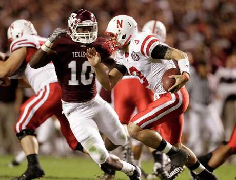Nebraska's QB Taylor Martinez (3) runs the ball against Texas A&M's Sean Porter (10) during the first quarter of the Texas A&M-Nebraska college football game, Nov. 20, 2010, at Kyle Stadium in College Station. The Aggies won 9-6. Photo: Karen Warren, SAEN / Houston Chronicle