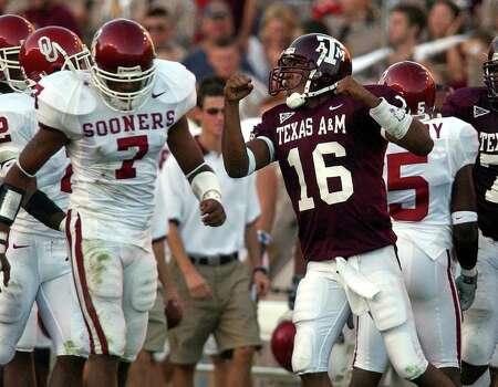 Texas A&M's rookie quarterback Reggie McNeal (16) reacts beside Oklahoma's Brandon Everage (07) as he helped lead the Aggies to a 30-26 win over Oklahoma at Kyle Field Stadium on Saturday, November 9, 2002. Photo: KIN MAN HUI, SAEN / SAN ANTONIO EXPRESS-NEWS