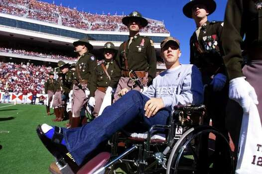Texas A&M senoir Chip Thiel (leg in cast) sits in his wheelchair amongst his fellow Corps of Cadets members while watching the UT A&M game at Kyle Field. Thiel was injured when the Aggie Bonfire collapsed last Thursday Nov. 18, 1999. A&M beat No. 5 Texas 20-16 a week after the Bonfire collapsed and killed 12 Aggies. Photo: DOUG SEHRES, SAEN