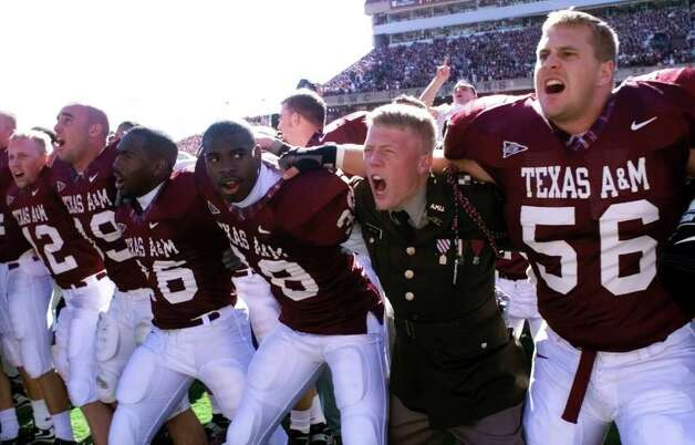 Texas A&M players and Corps of Cadets members get together for the Aggie War Hymn after defeating the Texas Longhorns 20-16 at Kyle Field Fri,. Nov. 26, 1999. Photo: DOUG SEHRES, SAEN