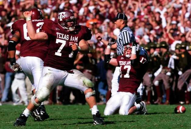 Texas A&M Seth McKinney (77), Semisi Heimuli (62) and Brian Gamble (17) celebrate a late fourth quarter fumble recovery to help seal the Aggies 20-16 win over UT at Kyle Field Fri. Nov. 26, 1999. Photo: DOUG SEHRES, SAEN