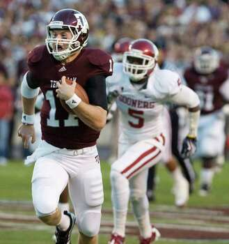 Texas A&M quarterback Ryan Tannehill (17) takes off on a 48-yard run against Oklahoma during the first half of an NCAA college football game Saturday, Nov. 6, 2010, in College Station, Texas. Pursuing is Oklahoma's Joseph Ibiloye (5). The Aggies won 33-19. Photo: SAEN