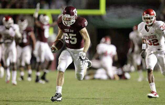 Texas A&M wide receiver Ryan Swope (25) runs for a 64-yard touchdown reception on a pass from Texas A&M quarterback Ryan Tannehill, not pictured, that gave the Aggies a 33-17 lead with 7:50 to play in the fourth quarter of an NCAA Football game between Texas A&M and Oklahoma at Kyle Field on Saturday, Nov. 6, 2010, in College Station. Texas A&M wound up winning 33-19 taking the upset victory on its last home game of the season. Photo: Julio Cortez, SAEN / © 2010 Houston Chronicle