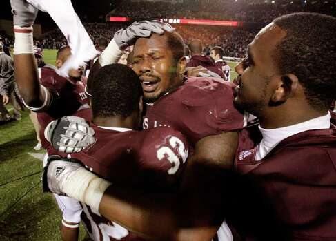 Texas A&M defensive end Von Miller (40) center, cries as he is congratulated by teammates, including Cyrus Gray (32), after the team beat Oklahoma 33-19 in an NCAA Football game between Texas A&M and Oklahoma at Kyle Field on Saturday, Nov. 6, 2010, in College Station. Photo: Julio Cortez, SAEN / © 2010 Houston Chronicle