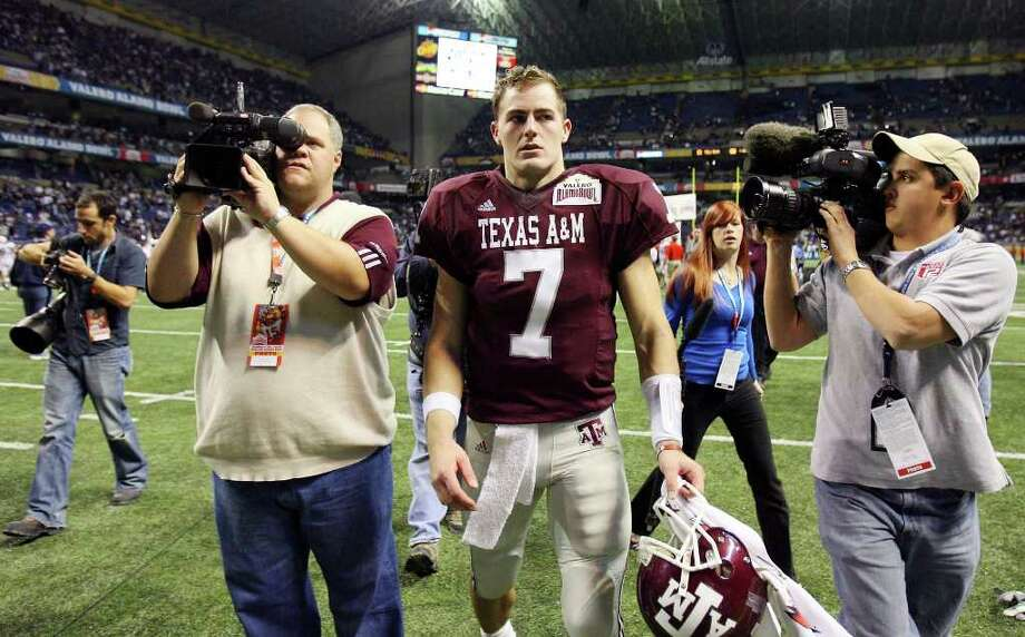Texas A&M's Stephen McGee heads off the field after the Aggies lost to Penn State 24-17 in the Valero Alamobowl Saturday Dec. 29, 2007 at the Alamodome. The Aggies lost 24-17. Photo: EDWARD A. ORNELAS, SAEN / SAN ANTONIO EXPRESS-NEWS
