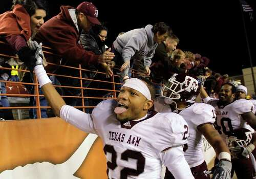 Texas A&M players celebrate their 24-17 victory over Texas, Thursday, Nov. 25, 2010 in Austin, Texas. Photo: SAEN