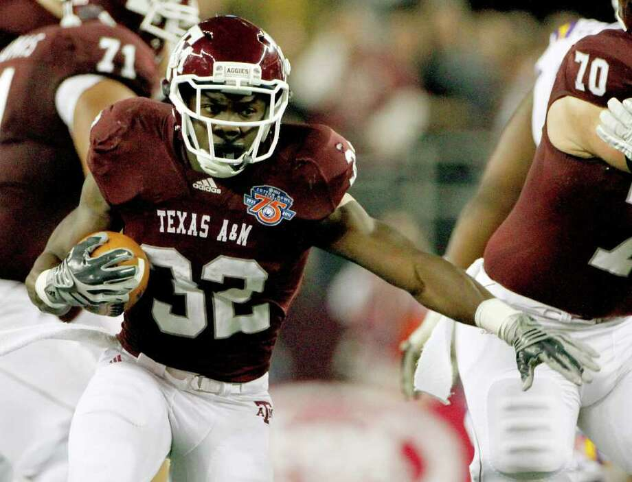 Texas A&M running back Cyrus Gray carries the ball against LSU during the first half of the Cotton Bowl NCAA college football game, Friday, Jan. 7, 2011, in Arlington, Texas. The Aggies lost 41-24. One of the lows of Texas A&M's time with the Big 12 was the team's 1-9 bowl record. Photo: SAEN