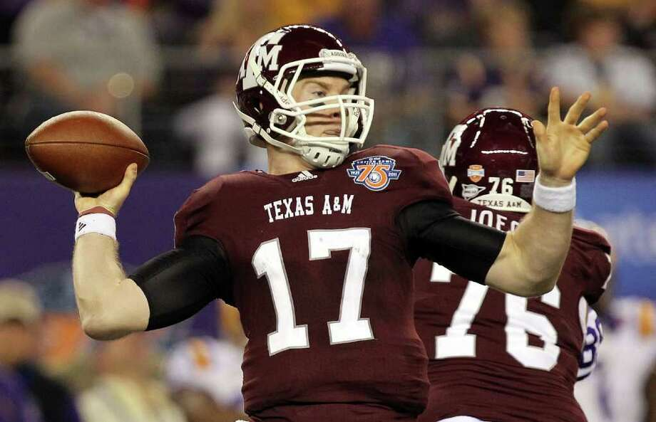Quarterback Ryan Tannehill #17 of the Texas A&M Aggies throws against the LSU Tigers during the AT&T Cotton Bowl at Cowboys Stadium on January 7, 2011 in Arlington, Texas. The Aggies lost 41-24. Photo: Ronald Martinez, SAEN / 2011 Getty Images