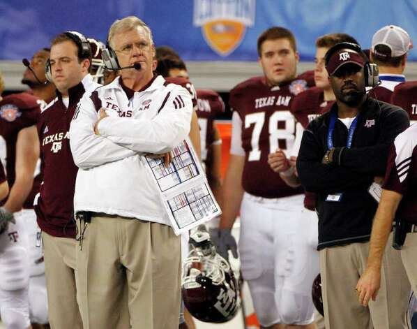 In this Jan. 7, 2011 photo, Texas A&M head coach Mike Sherman, left looks on from the sideline during the second half of the Cotton Bowl NCAA college football game against LSU in Arlington, Texas. The Aggies lost 41-24. Photo: SAEN