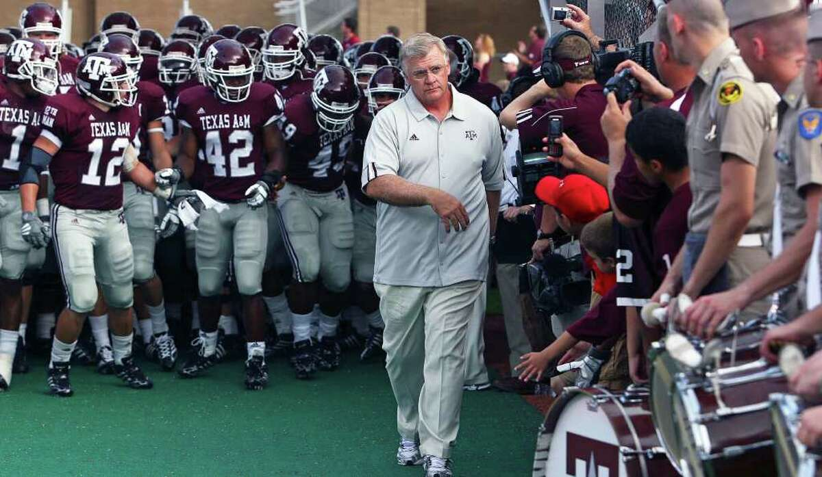 SPORTS Mike Sherman leads the Aggies onto the field as Texas A&M plays Arkansas State at Kyle Field in College Station on August 30, 2008. Tom Reel/Staff