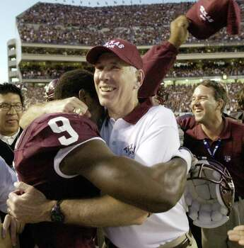 Texas A&M coach R.C. Slocum hugs Bethel Johnson (9) after beating top-ranked Oklahoma, 30-26, Saturday, Nov. 9, 2002, in College Station, Texas. The victory was not enough to save Slocum's job, however. Photo: BRETT COOMER, SAEN / AP
