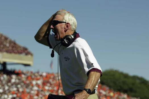 Head coach R.C. Slocum of the Texas A&M Aggies clutches his head during the NCAA football game against the Virginia Tech Hokies on September 21, 2002 at Kyle Field in College Station, Texas. The Hokies won 13-3. Slocum was fired after the team went 6-6 that season Photo: Ronald Martinez, SAEN / 2002 Getty Images