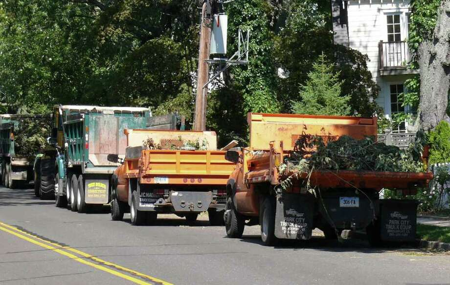 Town Department of Public Works crews continue to clean up the downed trees and debris from Irene. Photo: Genevieve Reilly / Fairfield Citizen