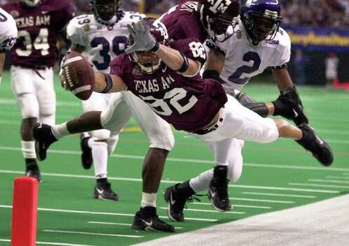 Texas A&M receiver Jamaar Taylor dives towards the pileon on a 15-yard pass play against TCU in the first half of the Gallery Furniture.Com Bowl Friday, December 28, 2001 at the Astrodome. Officials marked the ball down at the four. The Aggies won 28-9. One of the lows of Texas A&M's time with the Big 12 was the team's 1-9 bowl record. Photo: BAHRAM MARK SOBHANI, SAEN