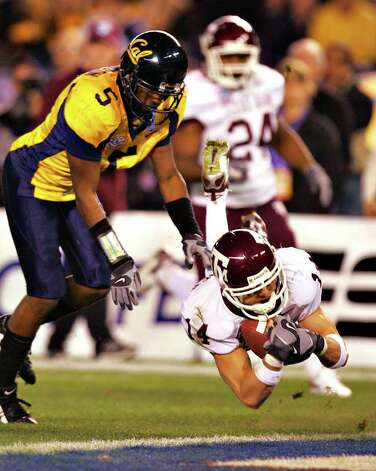 Texas A&M receiver Chad Schroeder falls into the endzone with a touchdown catch in front of Cal's Syd'Quan Thompson in the first half of the Holiday Bowl Thursday, December 28, 2006 at Qualcomm Stadium in San Diego. The Aggies lost 45-10. One of the lows of Texas A&M's time with the Big 12 was the team's 1-9 bowl record. Photo: BAHRAM MARK SOBHANI, SAEN / SAN ANTONIO EXPRESS NEWS