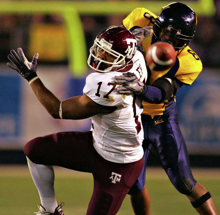 Texas A&M receiver L'Tydrick Riley can't make a catch as he is defended by Cal's Mickey Pimentel in the second half of the Holiday Bowl Thursday, December 28, 2006 at Qualcomm Stadium in San Diego. The Aggies lost 45-10. One of the lows of Texas A&M's time with the Big 12 was the team's 1-9 bowl record. Photo: BAHRAM MARK SOBHANI, SAEN / SAN ANTONIO EXPRESS NEWS