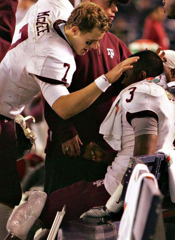 Texas A&M quarterback Stephen McGee consoles teammate Mike Goodson after Goodson went out with a leg injury in the second half of the Holiday Bowl Thursday, December 28, 2006 at Qualcomm Stadium in San Diego. The Aggies lost to the Golden Bears, 45-10. One of the lows of Texas A&M's time with the Big 12 was the team's 1-9 bowl record. Photo: BAHRAM MARK SOBHANI, SAEN / SAN ANTONIO EXPRESS NEWS