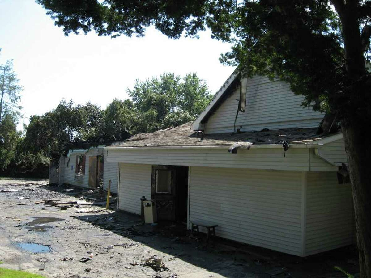 The Lake Forest Association clubhouse, the venue for countless wedding receptions, showers and other functions since the 1950s, burnt nearly to the ground early Wednesday morning, August 31, 2011. Hereís a rear view of the structure.