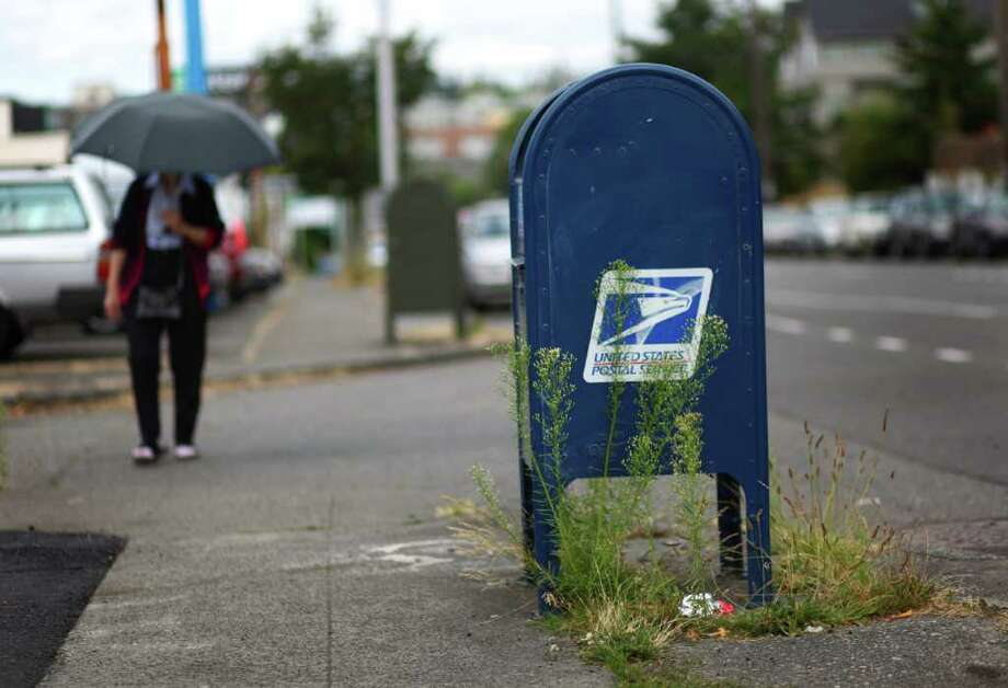 The venerable corner mailbox is disappearing as the U.S. Postal Service struggles financially. Photo: JOSHUA TRUJILLO / SEATTLEPI.COM