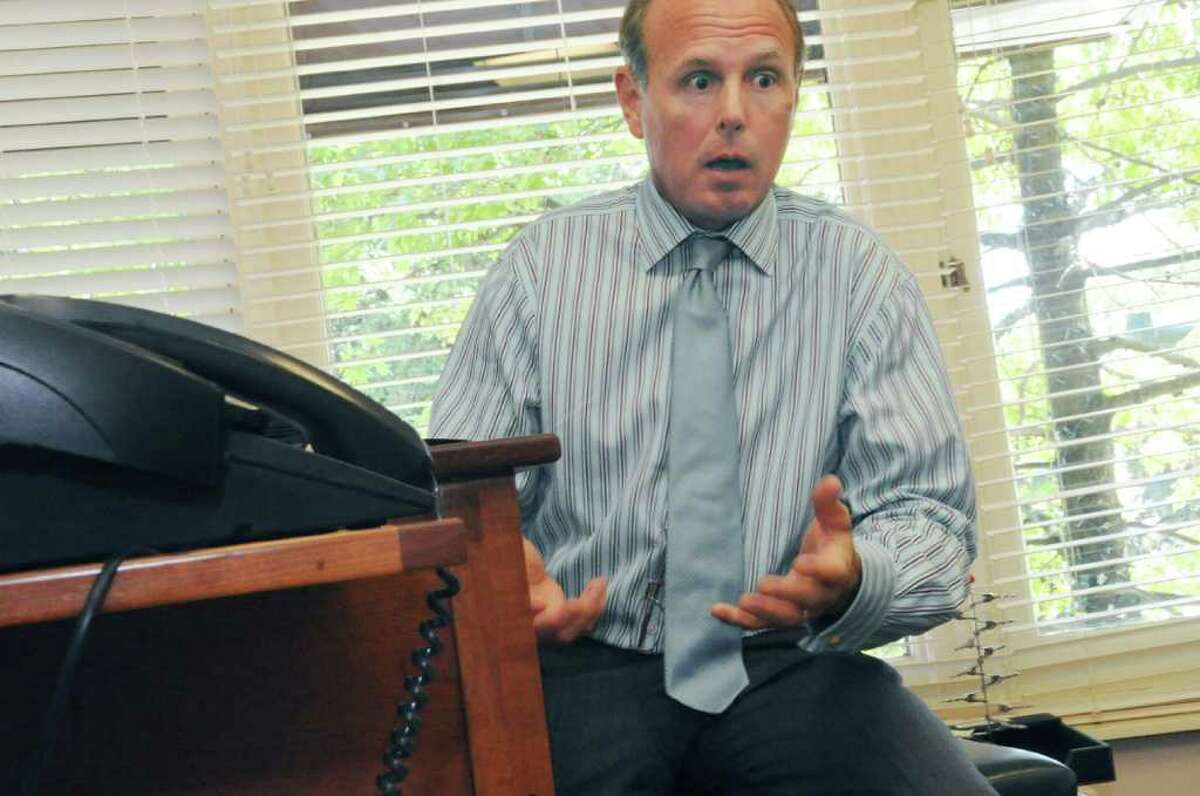 Michael Freeburg, a survivor of the Sept. 11 attacks, speaks in his Greenwich office on Wednesday, Aug. 13, 2011, of his experience on 9/11, when he worked as a trader in the World Financial Center.