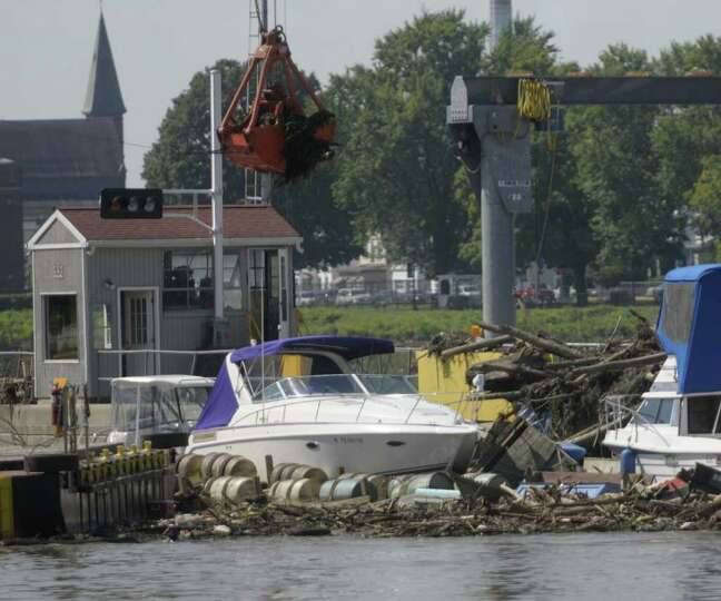Boats that broke loose and debris fill in around the Federal Lock at the Troy dam in Troy on Wednesd