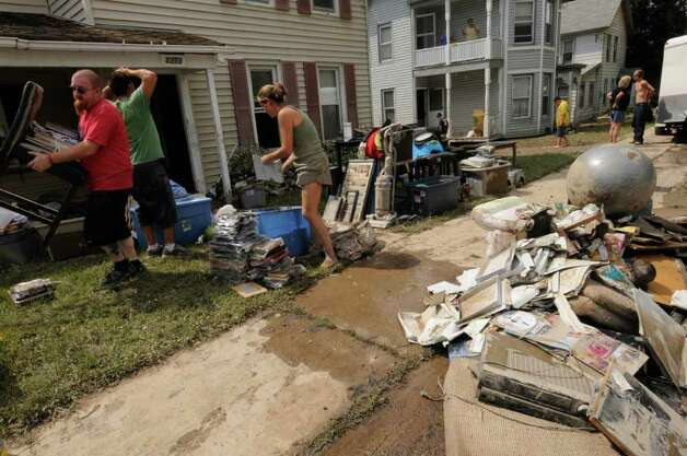 Residents clean out their homes along Route 5S in Rotterdam Junction Wednesday Aug. 31, 2011.( Michael P. Farrell/Times Union) Photo: Michael P. Farrell
