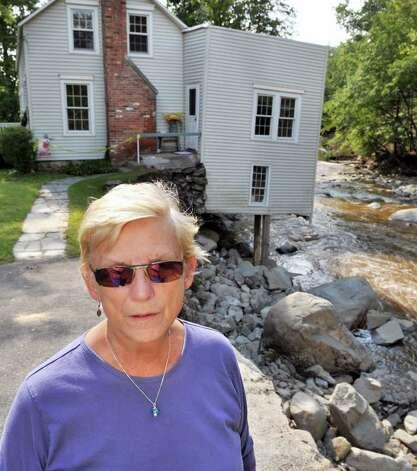 Audrey Davis outside her storm-damaged home on the banks of Poesten Kill in Poestenkill Wednesday Aug. 31, 2011.  The Plank Road home has been in Davis' family for 70 years.   (John Carl D'Annibale / Times Union) Photo: John Carl D'Annibale