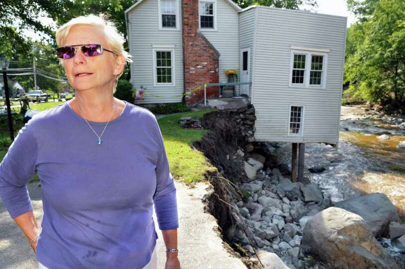 Audrey Davis outside her storm-damaged home on the banks of Poesten Kill in Poestenkill Wednesday Au