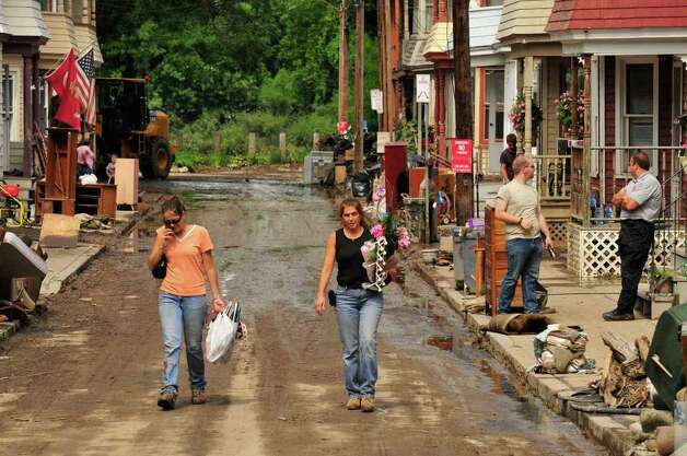Residents on Ingersoll Avenue clean up after flooding in the Stockade section of Schenectady, NY Wednesday Aug. 31, 2011.( Michael P. Farrell/Times Union) Photo: Michael P. Farrell