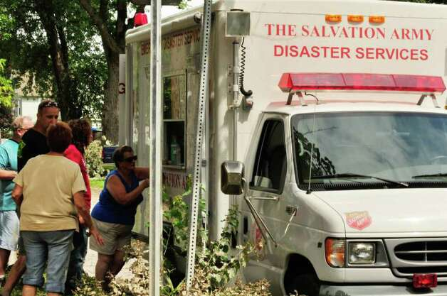 A Salvation Army Disaster Services truck supplies food and water to residents along Route 5S in Rotterdam Junction Wednesday Aug. 31, 2011.( Michael P. Farrell/Times Union) Photo: Michael P. Farrell