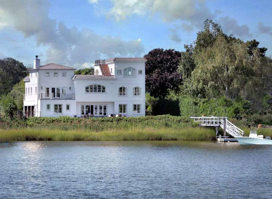 The 16-room Mediteranian home affords views of both Long Island Sound and a lagoon and features a deep-water dock. Photo: Contributed Photo / Westport News