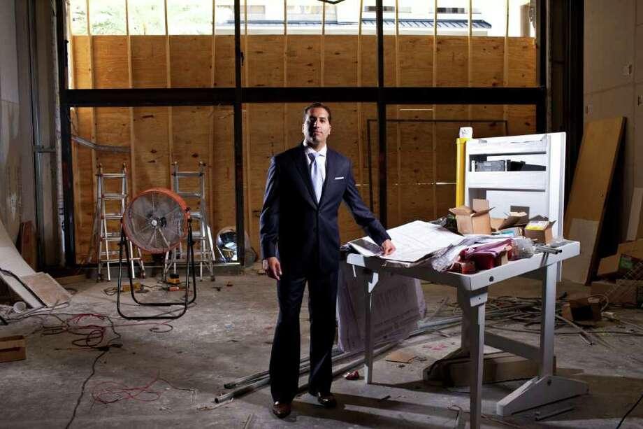 Raja Ratan, owner of Q Custom Clothier and Rye 51 July 14, 2011 in Houston. (Eric Kayne/For the Chronicle) Photo: Eric Kayne / © 2011 Eric Kayne