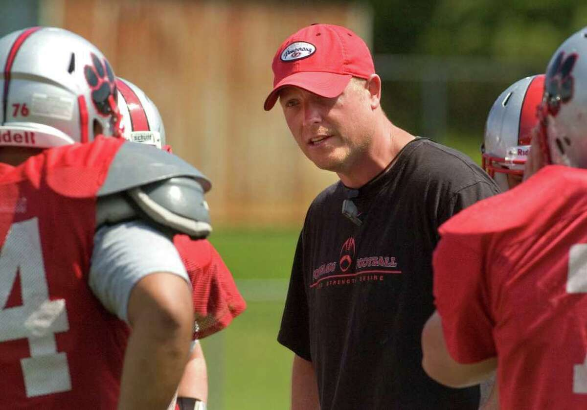 Pomperaug's new head coach Dave Roach gives orders during practice at Pomperaug High School in Southbury on Wednesday, Aug. 31, 2011.